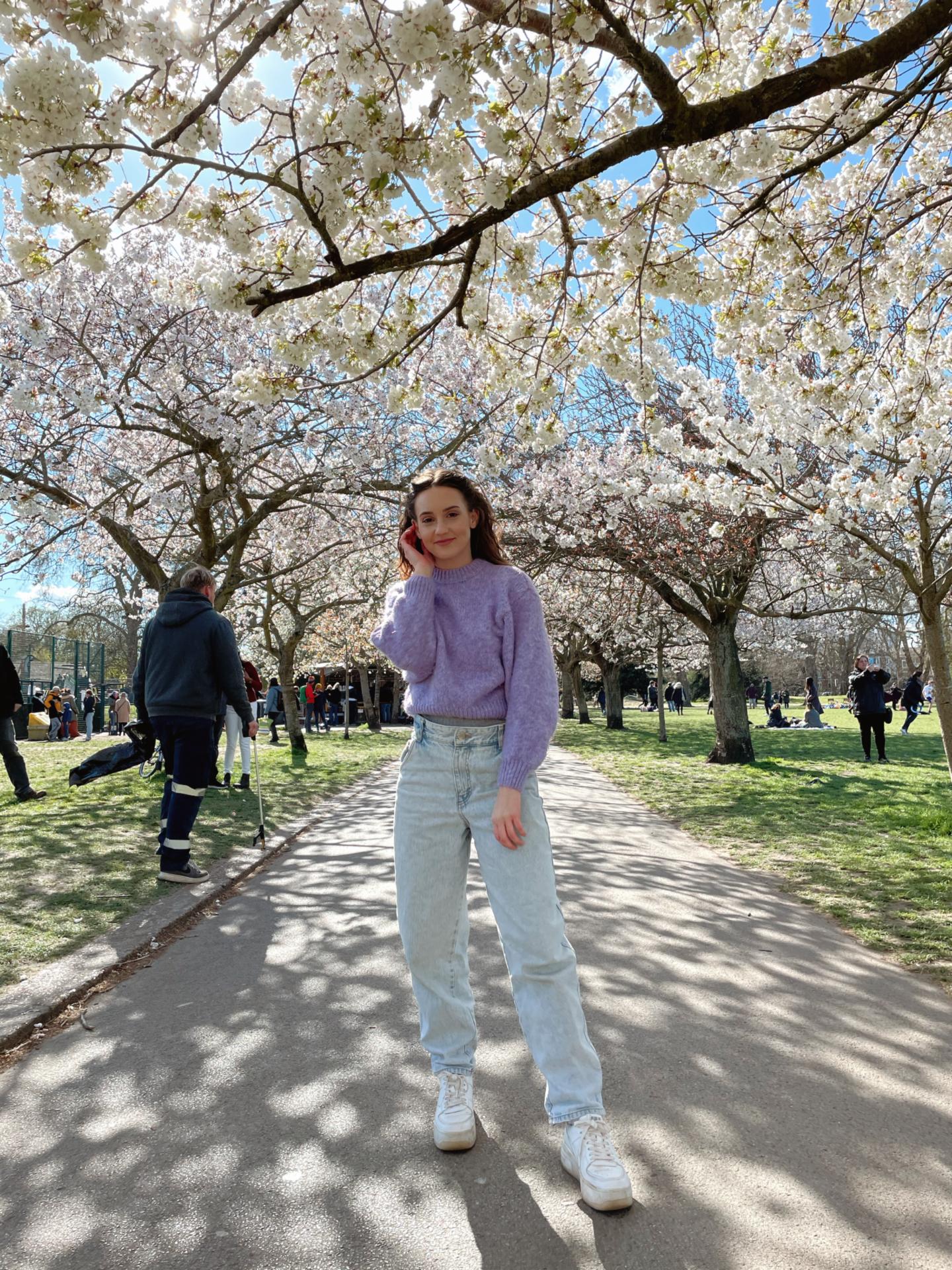 Girl in baggy jeans in park